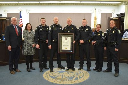 Battle Creek mayor, city manager, and police staff in group with police state accreditation