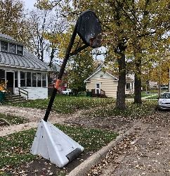 Street basketball hoop tagged with removal notice