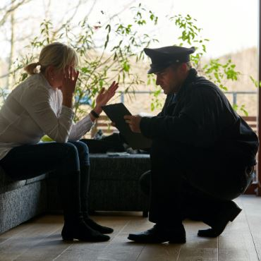 Detective speaking with woman