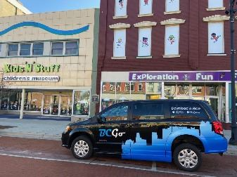 B C Go van in front of Kids and Stuff museum in Albion